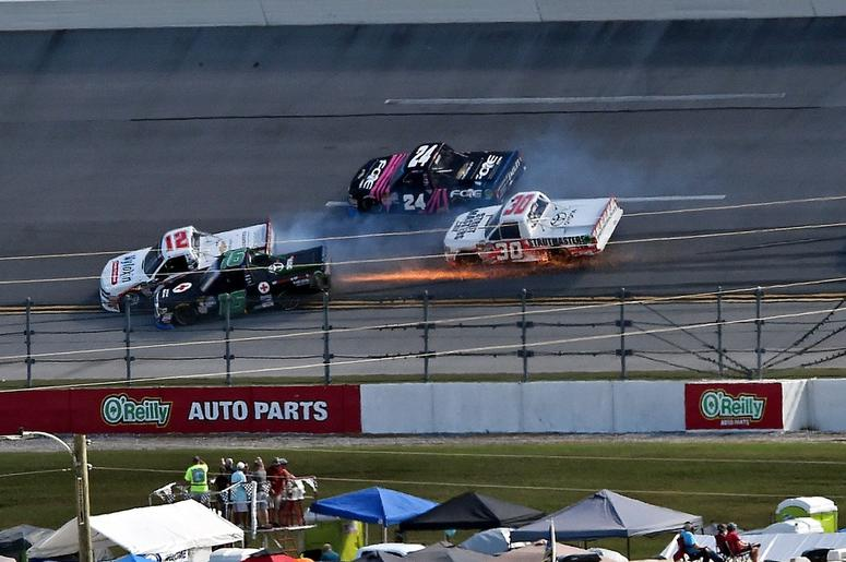 NASCAR Camping World Truck Series driver Jamie Mosley (150 and NASCAR Camping World Truck Series driver Tanner Thorson (12) wreck during the Talladega 250 at Talladega Superspeedway.