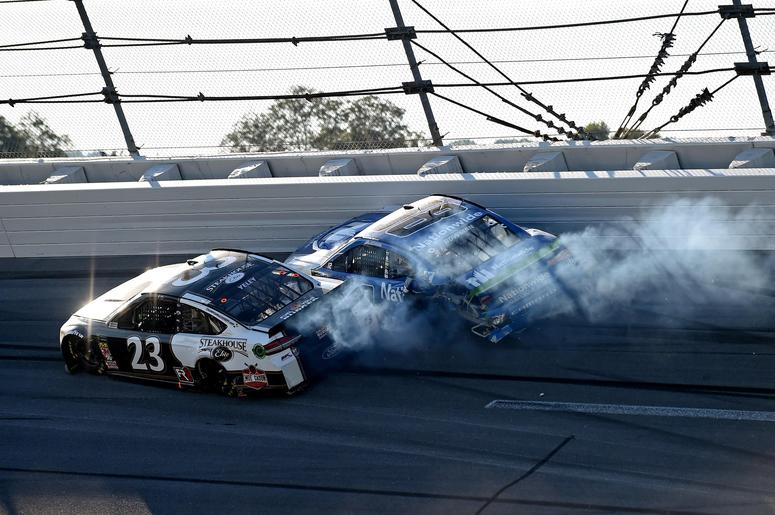 NASCAR Cup Series driver Alex Bowman (88) and NASCAR Cup Series driver JJ Yeley (23) wrecks during the 1000Bulbs.com at Talladega Superspeedway.
