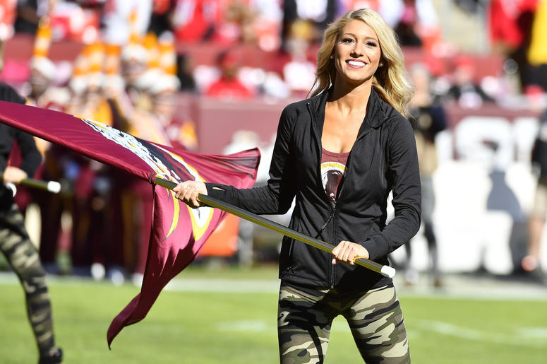 Washington Redskins cheerleader performs on the field before a game between the Washington Redskins and the Atlanta Falcons at FedEx Field