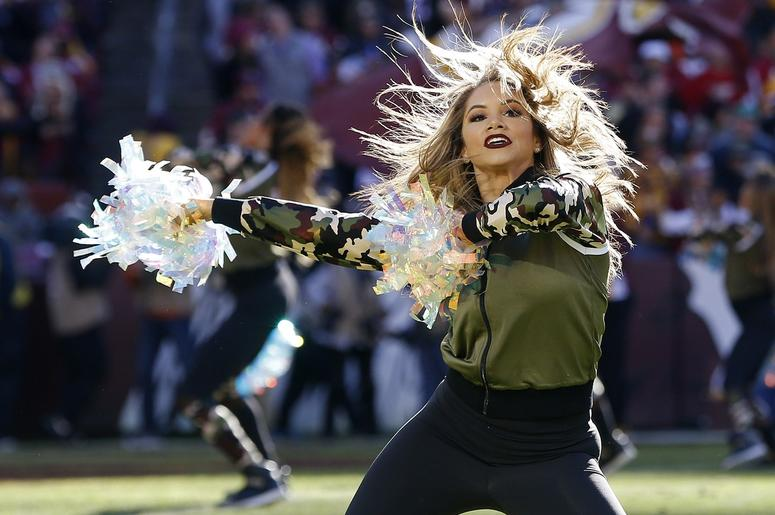 A Washington Redskins cheerleader dances on the field during a timeout against the Atlanta Falcons in the second quarter at FedEx Field