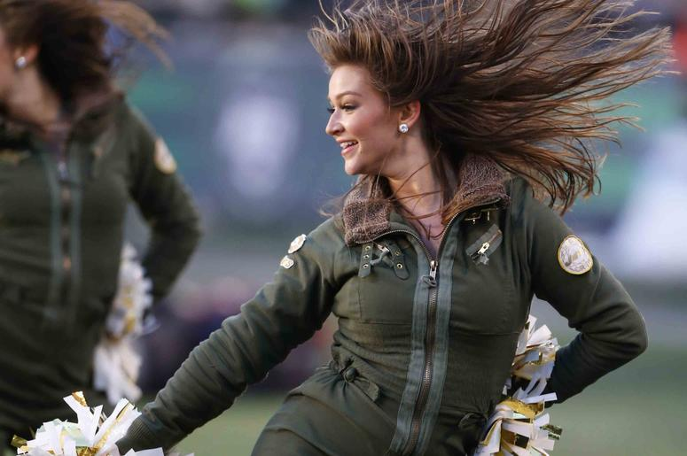 New York Jets cheerleader performs during the second half at MetLife Stadium