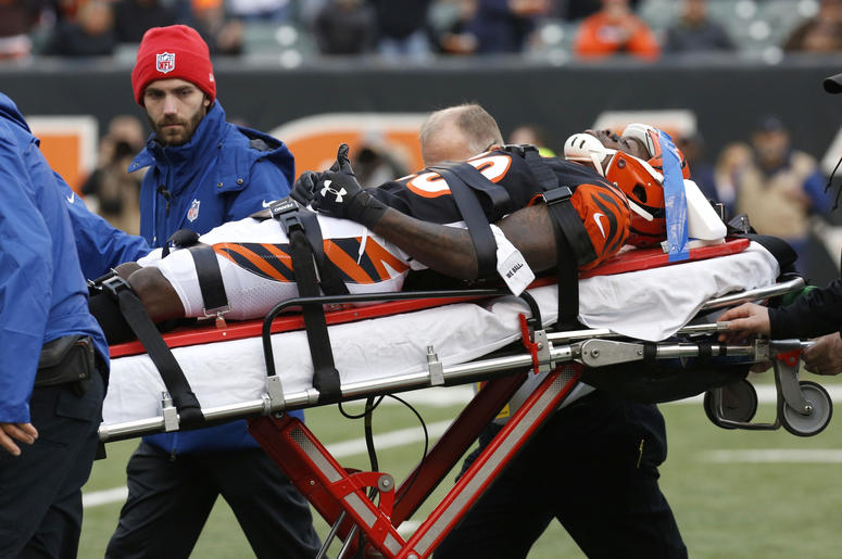 Cincinnati Bengals cornerback Tony McRae (29) is taken off the field after being hurt during the second half against the Cleveland Browns at Paul Brown Stadium.