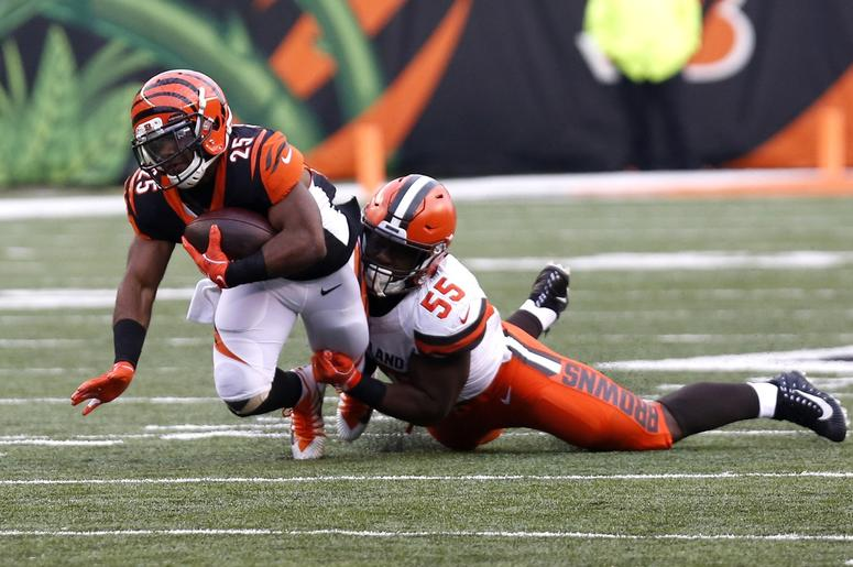 Cincinnati Bengals running back Giovani Bernard (25) is tackled by Cleveland Browns outside linebacker Genard Avery (55) during the second half at Paul Brown Stadium.
