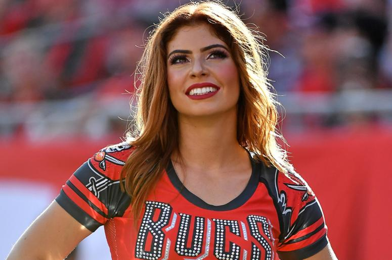 A Tampa Bay Buccaneers cheerleader poses during the second half between the Tampa Bay Buccaneers and the Atlanta Falcons at Raymond James Stadium.