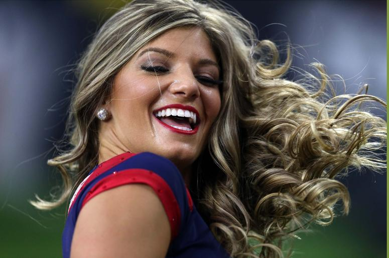A Houston Texans cheerleader performs while the Houston Texans play the Jacksonville Jaguars in the second half at NRG Stadium.