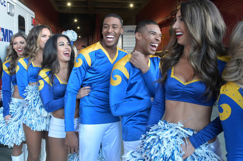 os Angeles Rams male cheerleaders Quinton Peron and Napolean Jnnies reat during the game against the San Francisco 49ers at Los Angeles Memorial Coliseum.