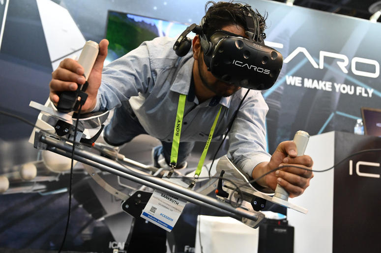 "Jan 9, 2019; Las Vegas, NV; Aneesh Sankruth tries out the Icaros Pro during the Consumer Electronics Show 2019 at the Sands Expo Convention Center. Icaros says their products ""Combines fitness with virtual reality and enables users to fly, dive or drive"