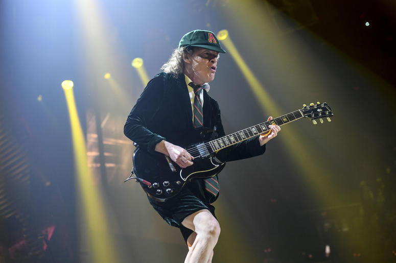 Angus Young performs