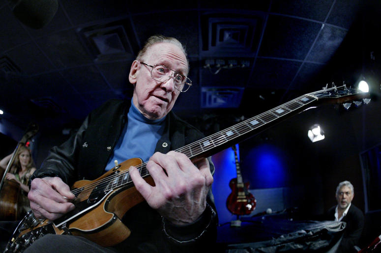 Les Paul plays a signature Les Paul