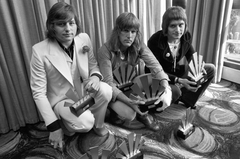 Greg Lake, Keith Emerson and Carl Palmer at Kennington Oval with their awards gained in the Melody Maker Polls. Keith Emerson died at the age of 71