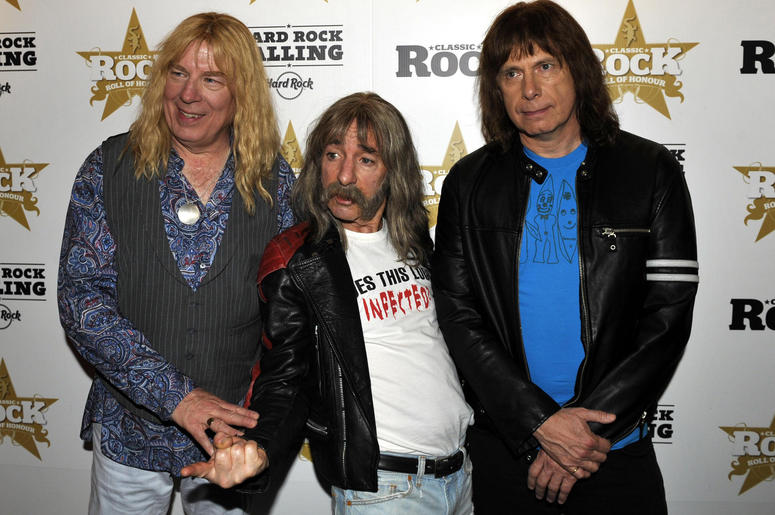 Spinal tap, featuring, from left, David St. Hubbins (Michael McKean), Derek Smalls (Harry Shearer) and Nigel Tufnel (Christopher Guest)
