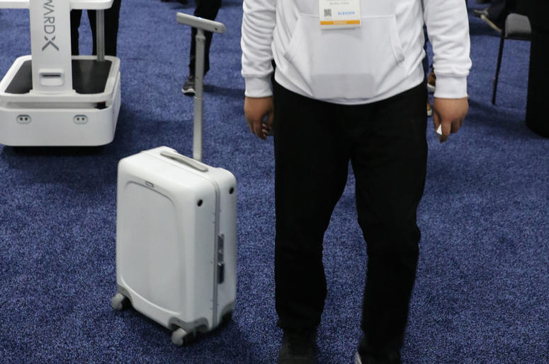 Zhaoqiang Chen of ForwardX Robotics demonstrates how ForwardX CX-1, an autonomous piece of luggage that's designed to follow people around as they make their way from point A to B, used at Unveiled Las Vegas, the 2019 Consumer Electronics Show (CES) media