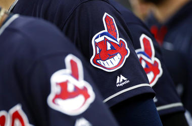 FILE - In this June 19, 2017 file photo, members of the Cleveland Indians wear uniforms featuring mascot Chief Wahoo as they stand on the field for the national anthem before a baseball game against the Baltimore Orioles in Baltimore. The maker of Clevela