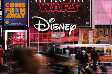 NEW YORK, NY - DECEMBER 14: The Disney logo is displayed outside the Disney Store in Times Square, December 14, 2017 in New York City. The Walt Disney Company announced on Thursday morning that it had reached a deal to purchase most of the assets of 21st