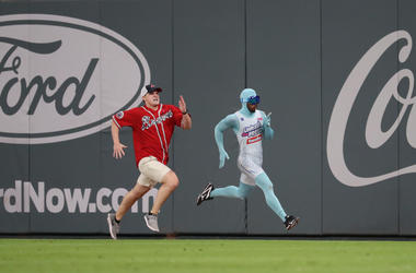 Sep 23, 2017; Atlanta, GA, USA; An Atlanta Braves fan is passed by The Freeze in a promotional contest during the game against the Philadelphia Phillies at SunTrust Park. Mandatory Credit: Jason Getz-USA TODAY Sports