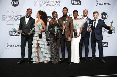 """Jan 27, 2019; Los Angeles, CA, USA; The cast of \""""Black Panther\"""" poses with their awards for outstanding performance by a cast in a motion picture for \""""Black Panther\"""" in the press room at the 25th Annual Screen Actors Guild Awards at the Shrine Auditor"""