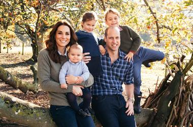 This photograph taken in the Autumn by Matt Porteous, shows The Duke and Duchess of Cambridge with their three children, Prince Louis, Princess Charlotte and Prince George (right) at Anmer Hall in Norfolk. This photograph features on their Royal Highnesse