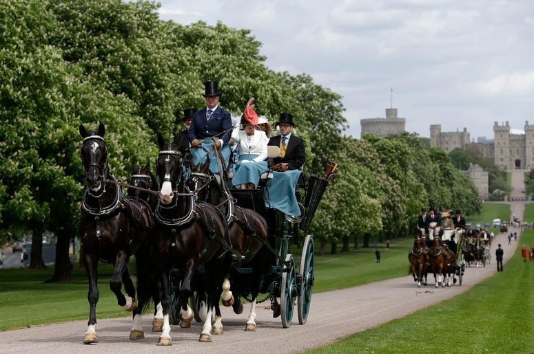 Horse-drawn carriages make their way down the Long Walk from Windsor Castle in Windsor