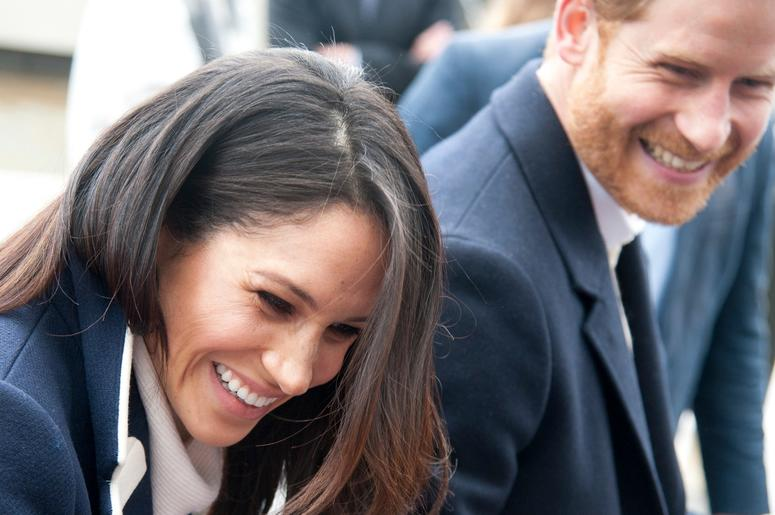 In this file photo dated Thursday March 8, 2018, Britain's Prince Harry and his fiancee Meghan Markle arrive for an event for young women, as part of International Women's Day in Birmingham, central England.