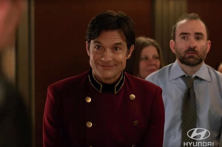 This undated image provided by Hyundai shows a scene from the company's 2019 Super Bowl NFL football spot starring Jason Bateman. As for celebrities, always a staple in Super Bowl ads, Jason Bateman appears as an affable elevator operator to showcase Hyun