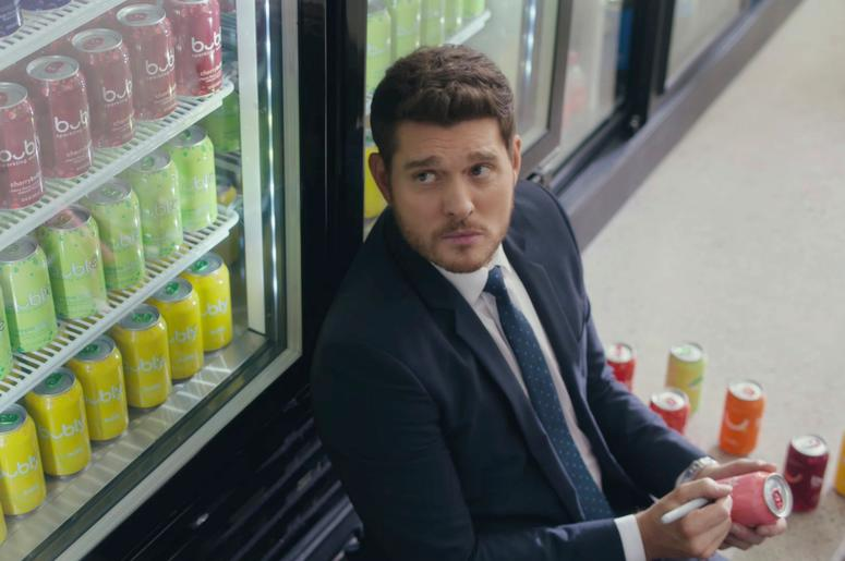 This undated screen grab from video provided by PepsiCo. shows an image from Pepsi's Bubly sparkling water brand's 2019 Super Bowl NFL football spot featuring Michael Bublé. Pepsi has long enlisted musicians to help sell its drinks and snacks. For its Dor