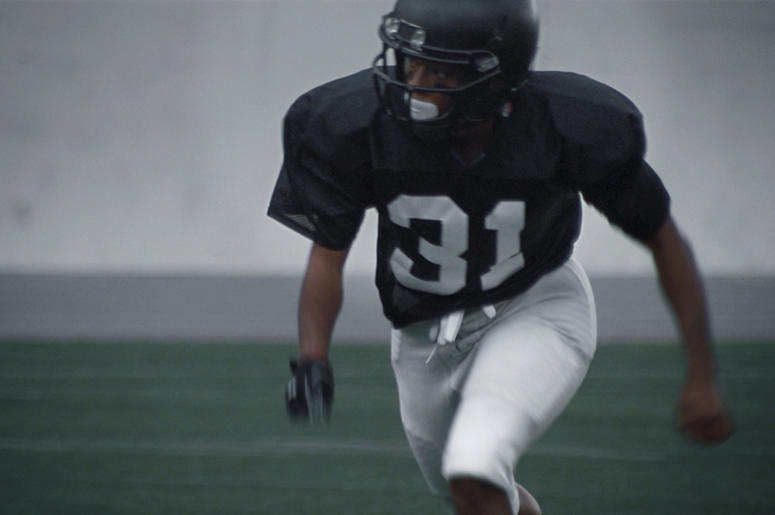 """This undated image provided by Toyota Motor North America shows a scene from the company's 2019 Super Bowl NFL football spot starring Antoinette """"Toni"""" Harris, a female football player at a California community college. (Toyota Motor North America via AP)"""