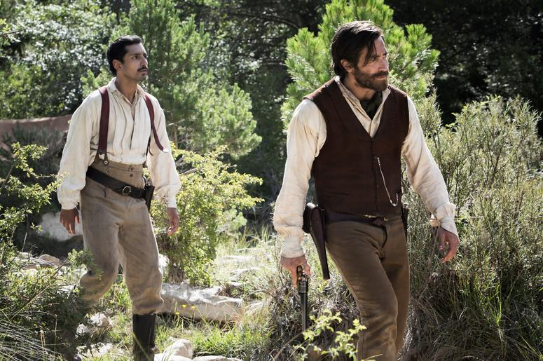 "Riz Ahmed (left) stars as ""Morris"" and Jake Gyllenhaal (right) stars as ""Hermann Kermit Warm"" in Jacques Audiard's THE SISTERS BROTHERS, an Annapurna Pictures release."