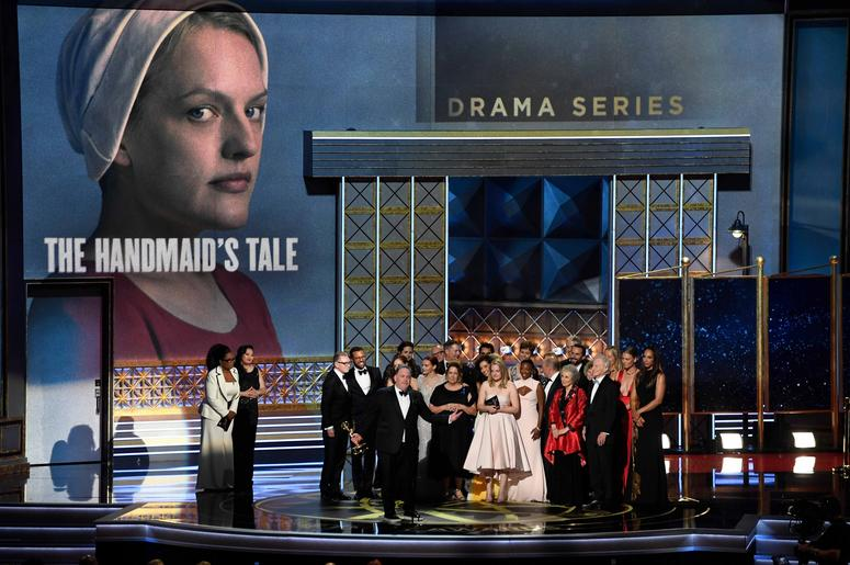 Sep 17, 2017; Los Angeles, CA, USA;  The cast of the Hulu series The Handmaid's Tale accepts the award for Drama Series during the 69th Emmy Awards at the Microsoft Theater. Mandatory Credit: Robert Hanashiro-USA TODAY