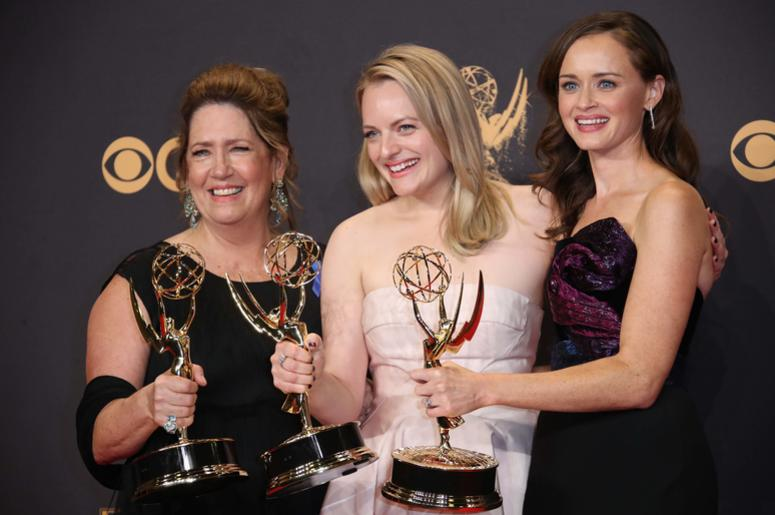 Sep 17, 2017; Los Angeles, CA, USA; From left, Ann Dowd , Elizabeth Moss and Alexis Bledel pose with their awards for Outstanding Drama Series for 'The Handmaid's Tale' in the trophy room during the 69th Emmy Awards at the Microsoft Theater. Mandatory Cre