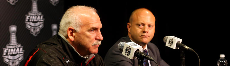 Blackhawks coach Joel Quenneville, left, and general manager Stan Bowman