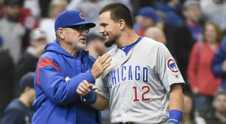 Cubs manager Joe Maddon, left, and outfielder Kyle Schwarber