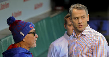 Cubs manager Joe Maddon, left, and general manager Jed Hoyer