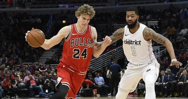 Bulls big man Lauri Markkanen drives to the hoop.