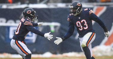 Bears cornerback Prince Amukamara, left, and Sam Acho, right
