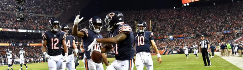 Anthony Miller (forefront) celebrates with Bears teammates after scoring a touchdown.
