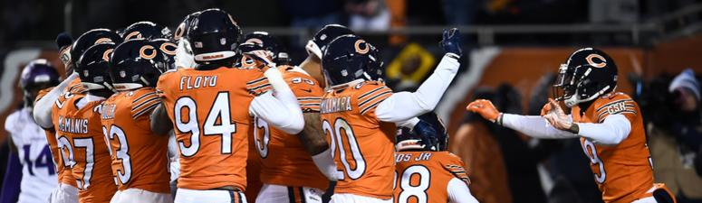 Eddie Jackson (39) leads the Bears in a celebration after returning an interception for a touchdown.