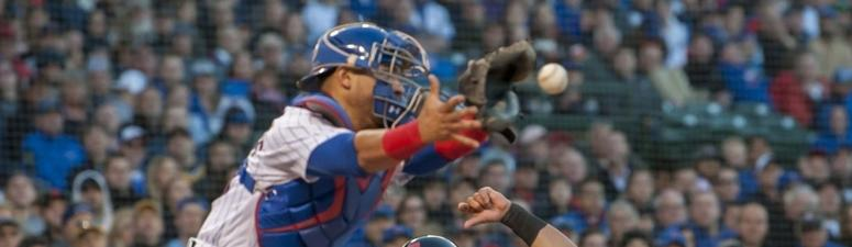 Indians right fielder Melky Cabrera slides safely into home as Cubs catcher Willson Contreras awaits the throw.