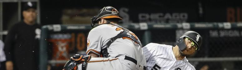 Orioles catcher Andrew Susac (27) tags out White Sox second baseman Yolmer Sanchez (5) at home plate.