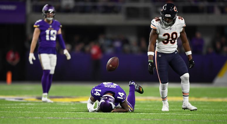 Bears safety Adrian Amos stands over Vikings receiver Stefon Diggs after an incomplete pass.