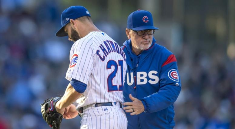 Cubs right-hander Tyler Chatwood is removed by manager Joe Maddon.