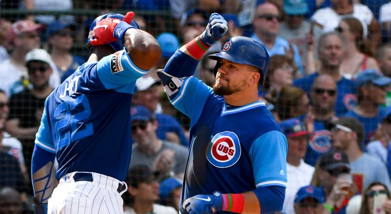 Jason Heyward, left congratulates Cubs teammate Kyle Schwarber.