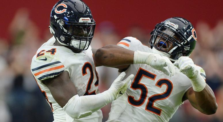 Bears running back Jordan Howard (24) and linebacker Khalil Mack (52) celebrate.