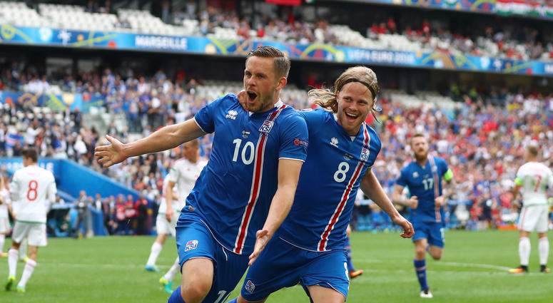 Gylfi Sigurdsson, left, celebrates with Iceland teammate Birkir Bjarnason after scoring a goal in 2016.