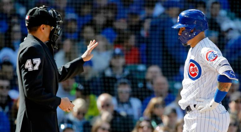 Cubs shortstop Javier Baez (9) talks with home plate umpire Gabe Morales after being called out on strikes.