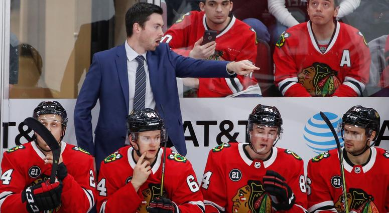 Blackhawks coach Jeremy Colliton directs his team.