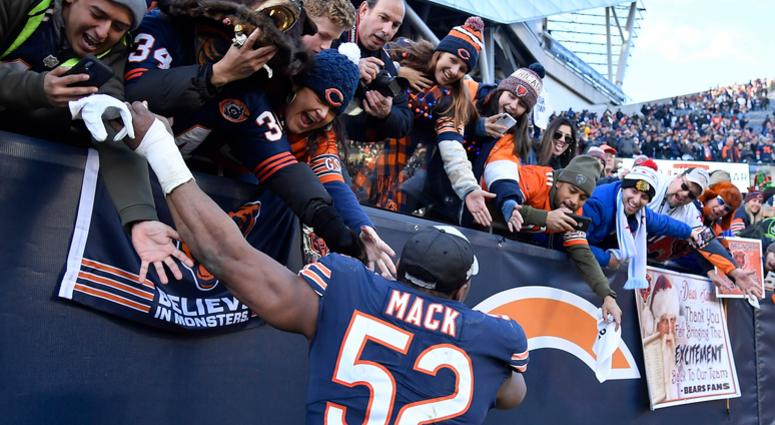 Bears outside linebacker Khalil Mack celebrates with fans after Chicago clinched the NFC North crown.