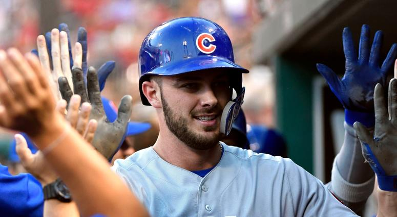 Cubs third baseman Kris Bryant is congratulated by teammates after homering.