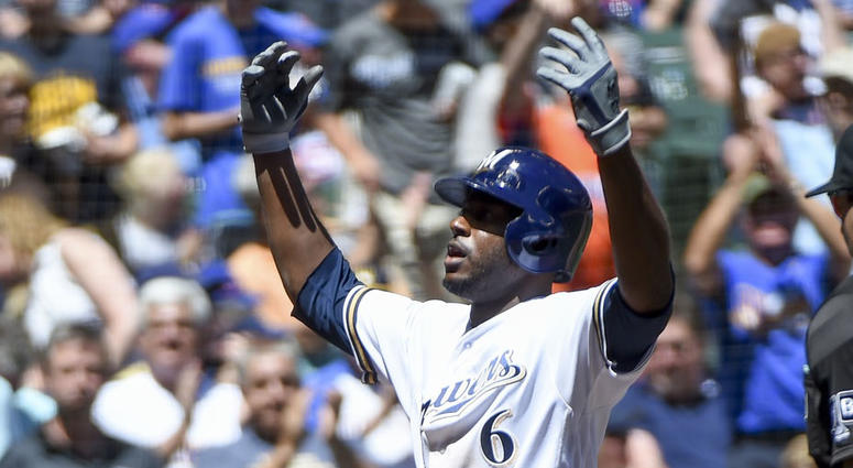 Brewers outfielder Lorenzo Cain celebrates his homer.