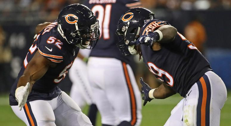 Bears linebacker Khalil Mack, left, and linebacker Danny Trevathan