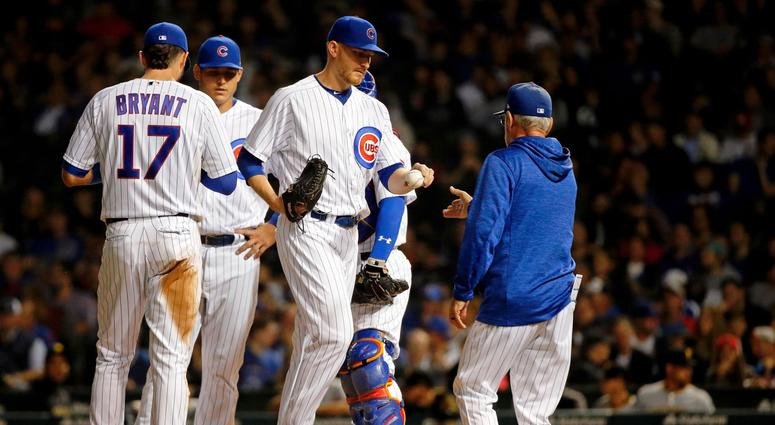 Cubs left-hander Mike Montgomery hands the ball to manager Joe Maddon as he's removed from the game.